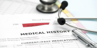 stethoscope and pen resting on a sheet of medical lab Medical History,
